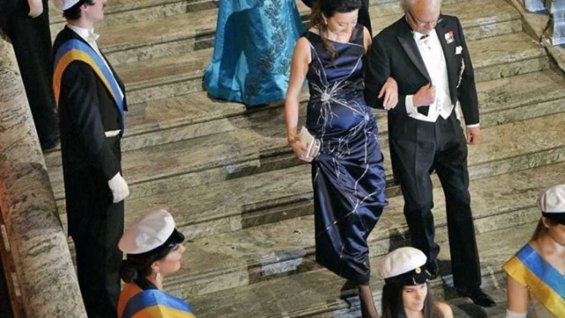 404 Scientist Accepts Nobel Prize Wearing Dress Depicting Her Discovery