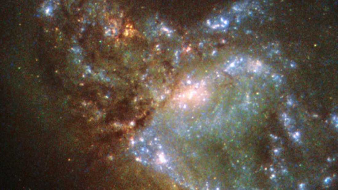410 Hubble Snaps Two Galaxies Slowly Becoming One