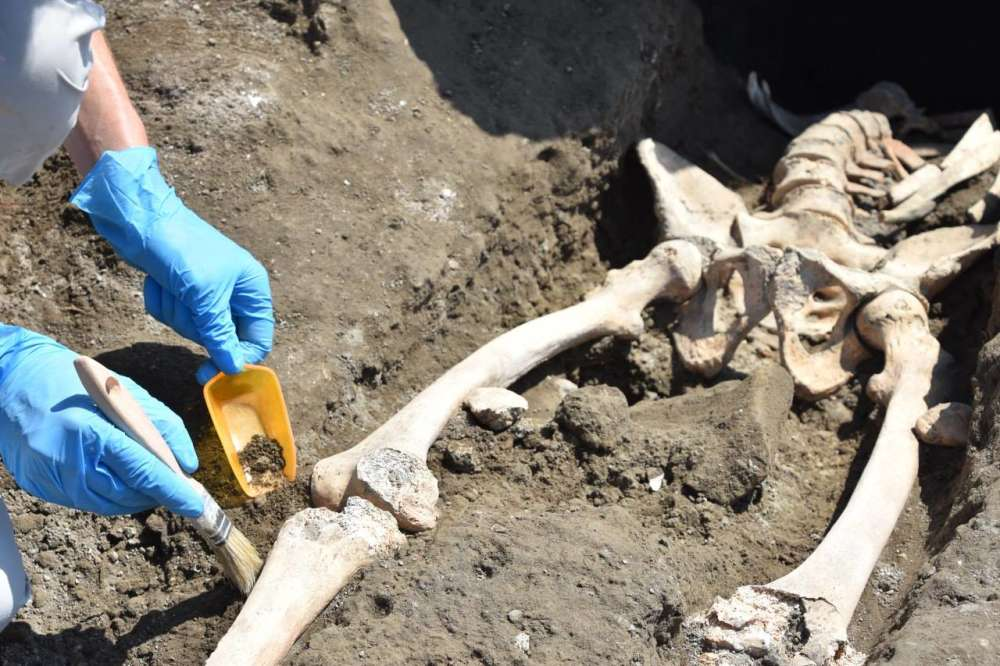 Archaeologists uncover remains of man crushed as he fled Pompeii