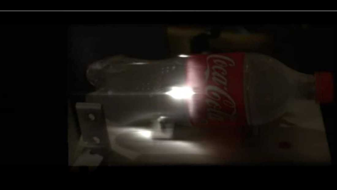 754 Laser Pulse Imaged Through Bottle At 1 Trillion Frames Per Second