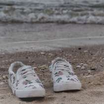 Sneakers washed up on a beach