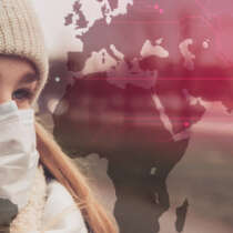 Woman in mask overlayed with a virus map concept of Asia